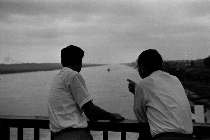 Sami & Yusef on a bridge over the Danube River